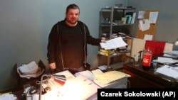 Rafal Gawel stands in his office in Warsaw, shortly after it was raided in February 2017 by the police, who seized computers.