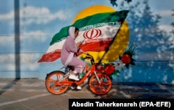A woman rides a bicycle in Tehran. The simple act of a woman riding a bicycle -- even while wearing a head scarf -- has been a controversial issue in Iran. Hard-liners, including influential clerics, have repeatedly spoken out against it.