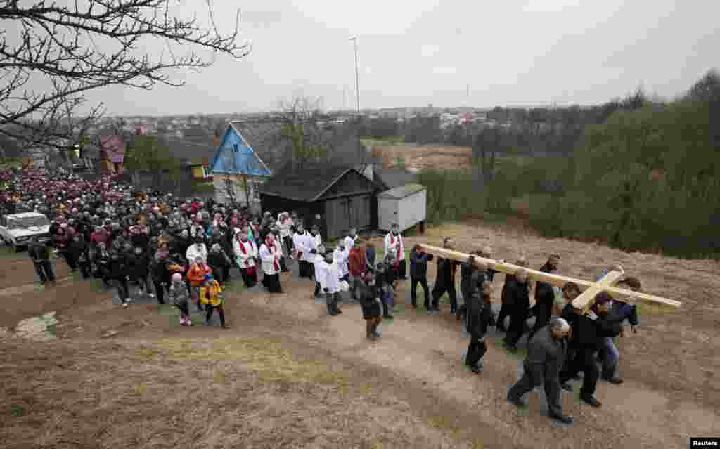 Belarusian Catholics carry a wooden cross as they take part in a procession celebrating Palm Sunday in the town of Oshmiany, northwest of Minsk, on March 29. (Reuters/Vasily Fedosenko)