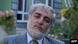 Afghan presidential candidate Abdullah Abdullah talks during an interview with AFP at his residence in Kabul on July 1.