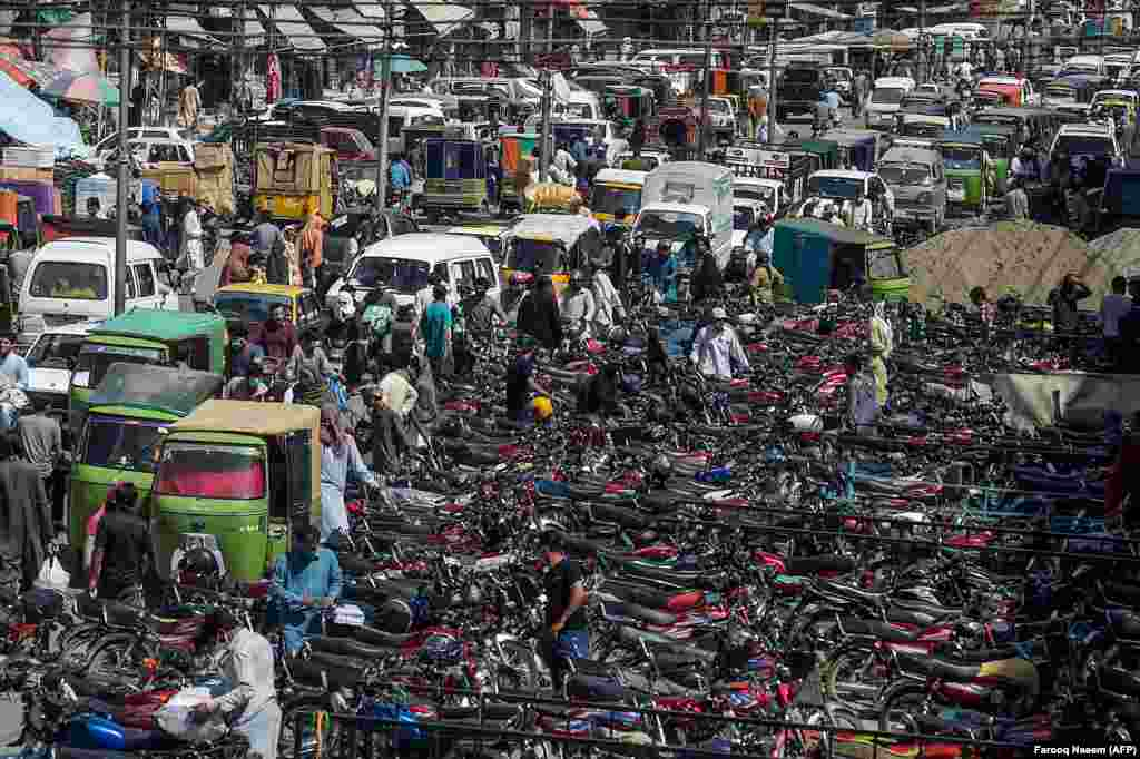 The area around the Raja Bazar in the Pakistani city of Rawalpindi was jammed with motorbikes on May 21 as people flocked to markets ahead of the Eid al-Fitr festival.