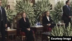 Queen Farah (R), widow of the late Shah of Iran and Jihan Sadat (L), widow of Egypt's assassinated former president Anwar Sadat, attend a memorial service of Mohammad Reza Pahlavi, August2017