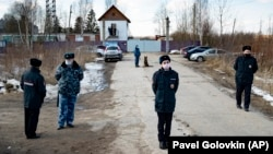 Police officers wearing face masks to protect against the coronavirus guard an entrance to Correctional Colony No. 2 in Pokrov on April 6.