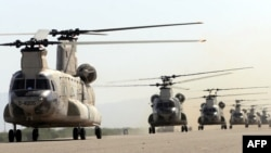 Iranian army helicopters take part in a military drill near the Strait of Hormuz in May, 2010
