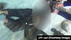 Afghan police on September 9 display the body of a suicide bomber.