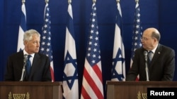 U.S. Defense Secretary Chuck Hagel (left) and his Israeli counterpart Moshe Yaalon at a joint news conference at Kirya base in Tel Aviv on April 22.