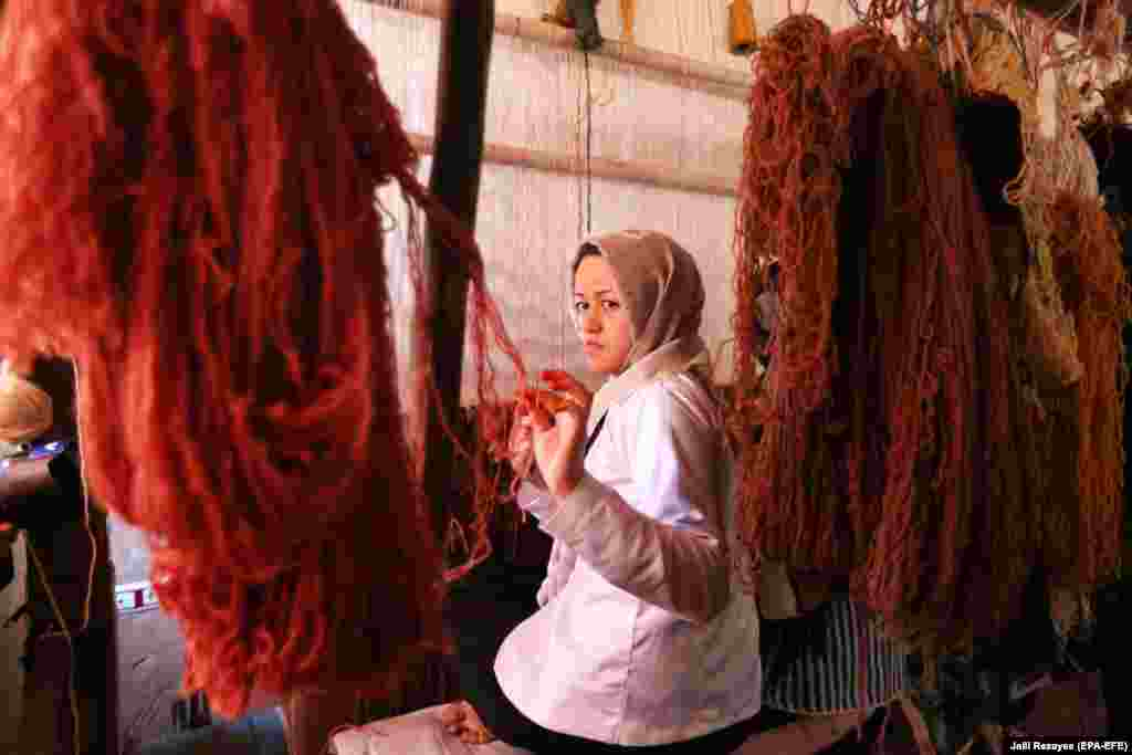 Afghan girls learn the skills to weave rugs at a small factory in the Enjil district of Herat Province. Afghanistan's hand-woven rugs require skilled labor and are in great demand all over the world. (epa-EFE/Jalil Rezayee)