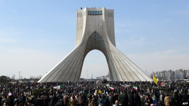 Iranians attend celebrations on Tehran's Azadi (Freedom) Square to mark the 37th anniversary of the Islamic Revolution on February 11.