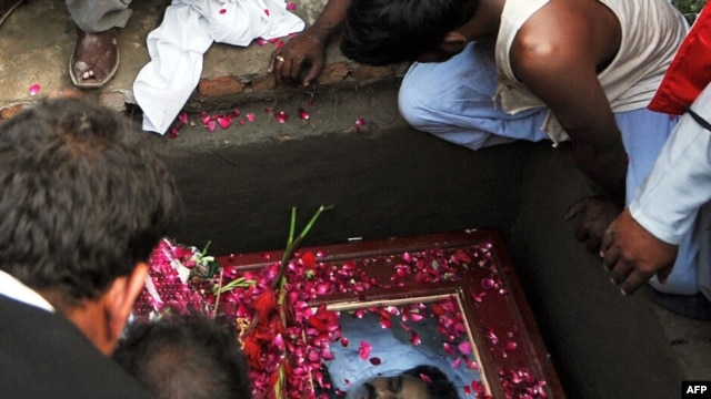 Mourners at the burial of slain Pakistani Minister for Minorities Shahbaz Bhatti at his family graveyard in his native village Khushpur, Pakistan, on March 4.