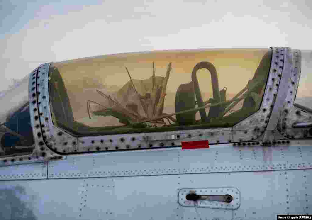 The cockpit of a Dolphin jet showing a pilot's sunshade. In 2018, according to local media, a Ukrainian politician took control of the airfield, with plans to restore it and at least some of the aircraft inside.