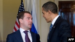 U.S. President Barack Obama (right) speaks with Russian President Dmitry Medvedev during a meeting at the U.S. ambassador's residence in London on April 1.