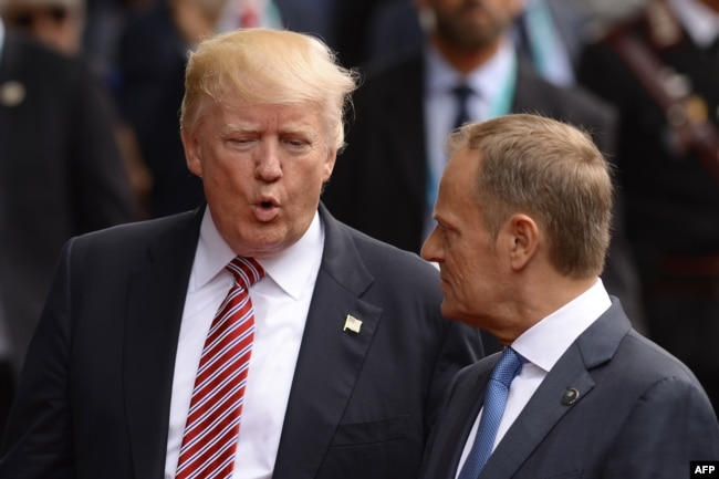 U.S. President Donald Trump (left) speaks with the president of the European Council, Donald Tusk, at the G7 summit.
