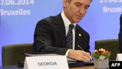 Ираклий Гарибашвили подписывает соглашение об ассоциации Грузии с ЕС