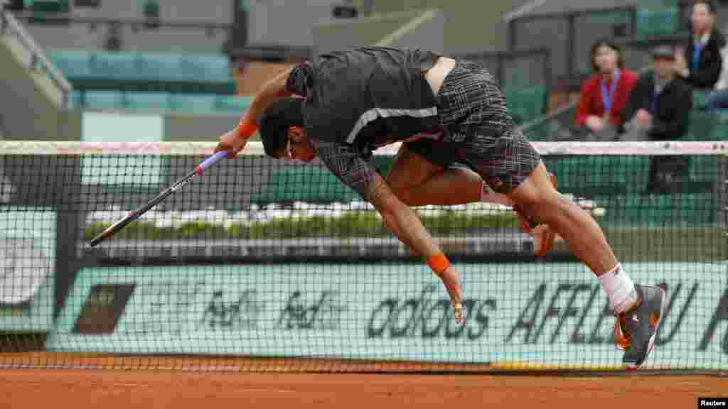 Janko Tipsarevic of Serbia returns the ball during the French Open tennis tournament at the Roland Garros stadium in Paris. (Reuters/Benoit Tessier)