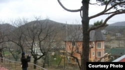 The activists say cottages were illegally built on the land controlled by Governor Aleksandr Tkachev.