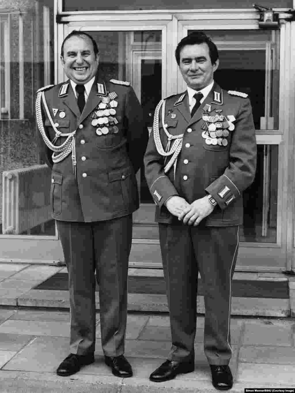 "Unidentified officers in front of the Stasi headquarters, the Ministry for State Security, in Berlin. Menner says he is finished with exploring the archive of millions of once-secret Stasi photos, but says, ""There is still so much more to see; it's endless material."""