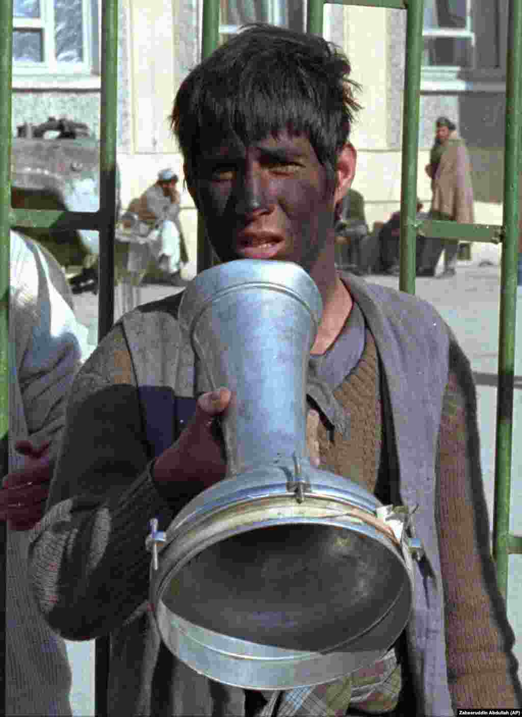 "A young man who had his face painted black after reportedly being caught stealing five carpets. He was later ""persecuted"" by the Taliban."