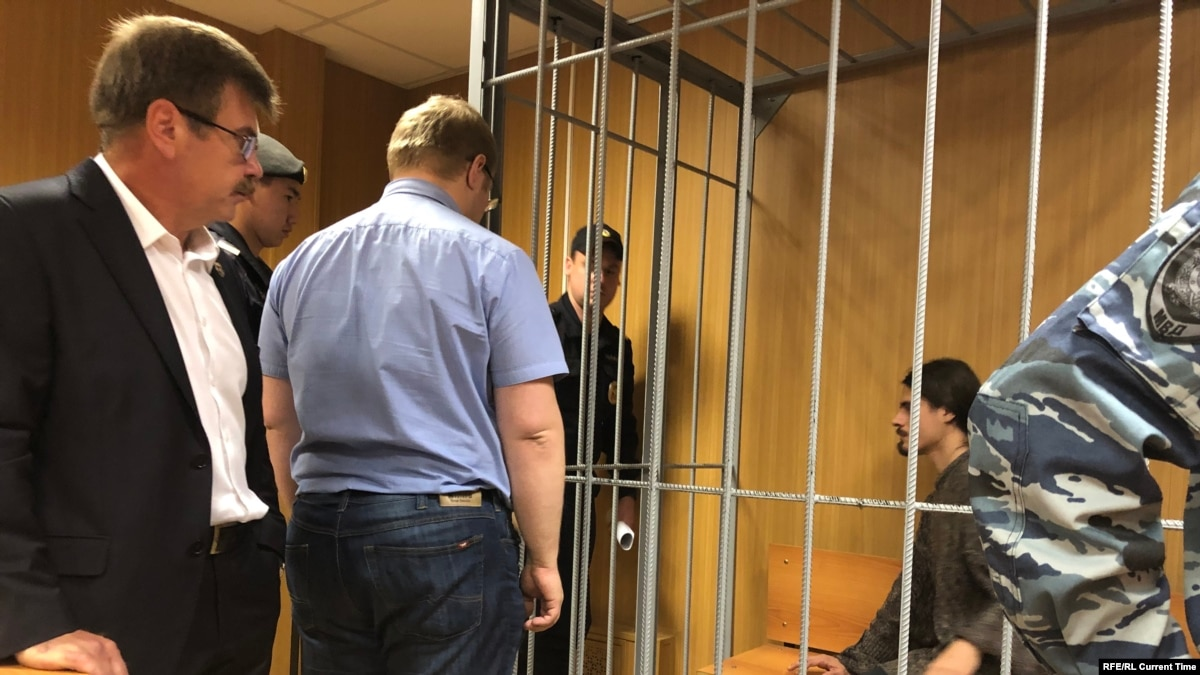 Court In Moscow Hands Prison Terms To Two Activists