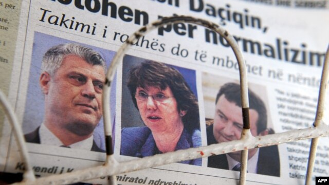 A local newspaper in Pristina shows Kosovar Prime Minister Hashim Thaci, European Union foreign policy chief Catherine Ashton, and Serbian Prime Minister Ivica Dacic (left to right) the day after their first meeting on October 19.