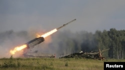 Russia -- A Russian TOS-1A multiple rocket launcher fires during the opening of the Army-2015 international military forum in Kubinka, outside Moscow, June 16, 2015