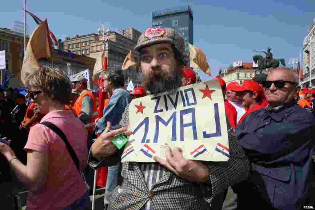 "A Croatian man holds a sign declaring ""Long Live May 1"" during International Workers' Day celebrations in the capital Zagreb. Photo by zoomzg for RFE/RL"