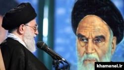 File photo - Iran's Supreme Leader Ali Khamenei before a portrait of his predecessor Ayatollah Ruhollah Khomeini, undated.