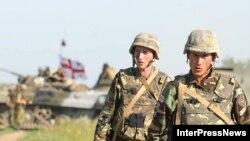 Бойцы грузинского миротворческого батальона в Южной Осетии уверяют, что открывают только ответный огонь