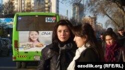 Uzbekistan - Uzbek girls are waiting for a public bus, undated