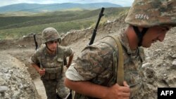 Nagorno-Karabakh -- Armenian soldiers of the self-proclaimed republic of Nagorno-Karabagh walk in a trench at the frontline on the border with Azerbaijan near the northeastern town of Martakert, 06Jul2012