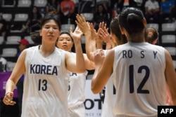 Женская сборная по баскетболу, объединившая спортсменок Северной и Южной Кореи на Азиаде. Джакарта, 15 августа 2018 года.