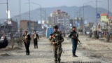 AFGHANISTAN -- Afghan security personnel gather at the site of bomb explosion in Kabul, February 26, 2020