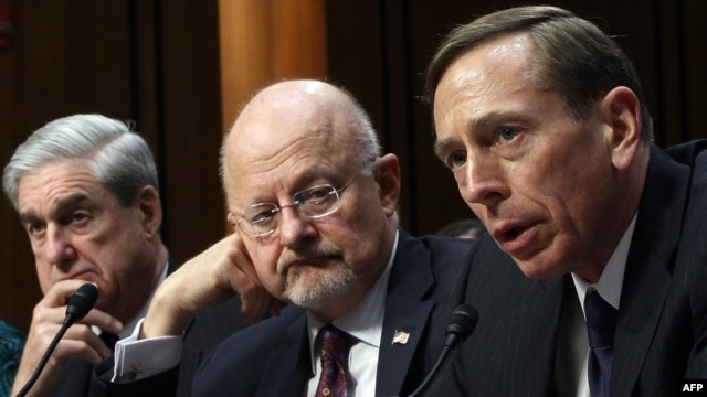 U.S.Director of National Intelligence James Clapper (center) and CIA Director David Petraeus (right) appear before with FBI Director Robert Mueller (left) before a Senate Select Committee on Intelligence in Washington on January 31.