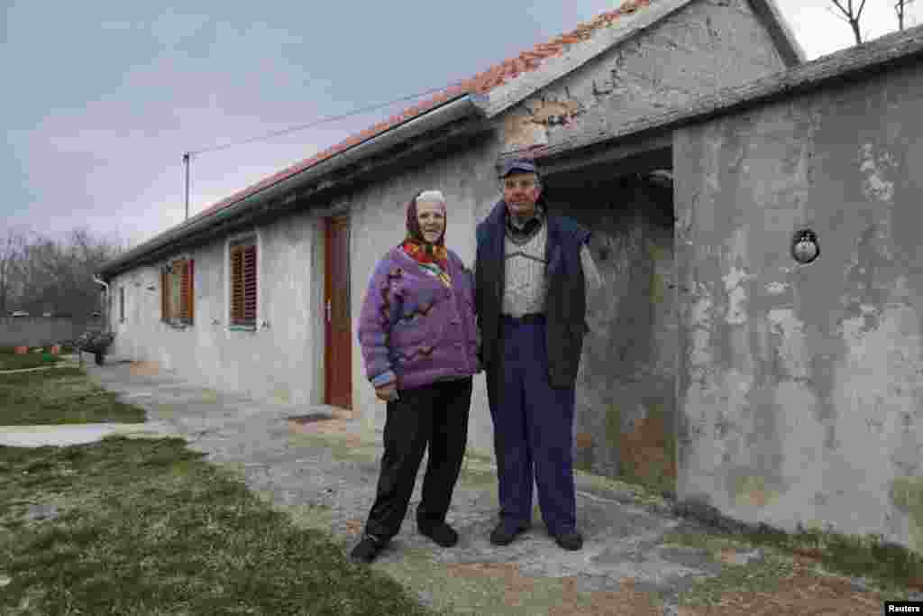 Nikola Jankovic, 83, poses with his wife, Dragonja, in the village of Bobodol, near Knin. Many of the homes nearby have been destroyed by fire and abandoned.