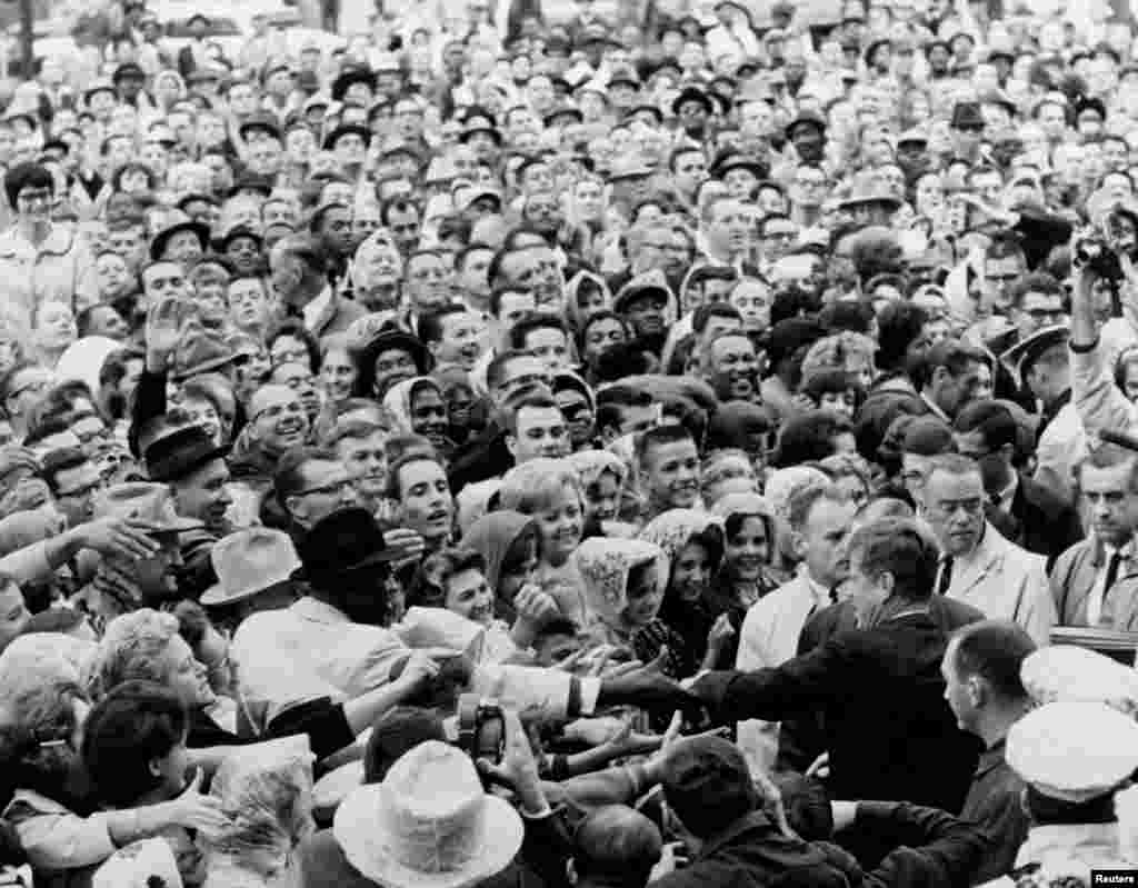 President John F. Kennedy greets a large crowd at a political rally in Fort Worth, Texas on the morning of November 22, 1963.