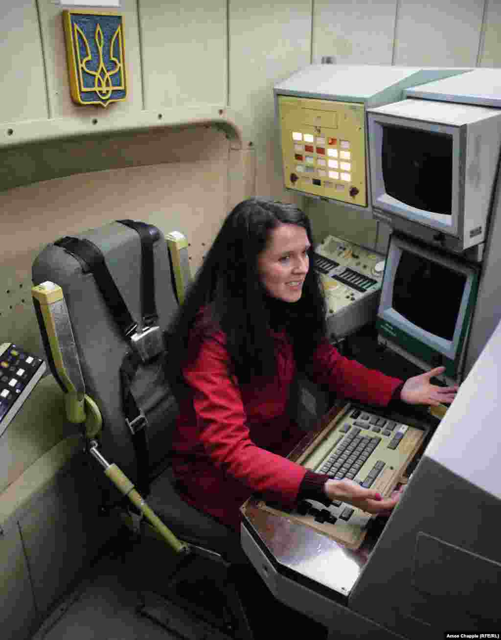 Local tour guide Olena Smerychevska (who works professionally as Elena Smerichevskaya) sitting at one of the two desks with access to the launch buttons.