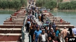 Sunni Arabs fleeing the violence in the Iraqi city of Ramadi arrive at the outskirts of Baghdad on April 19.
