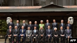 Министры финансов и главы центробанков G7 на заседании в японском курортном городе Акиу, 20 мая 2016 года