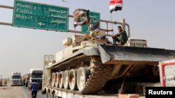 Конвой військової техніки іракських сил на шляху до Мосула