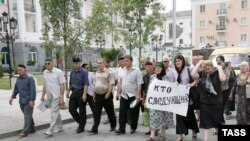 Funeral procession for slain human rights activist Natalia Estemirova.