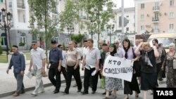 Funeral procession for slain human rights activist Natalia Estemirova.