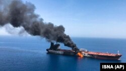 An oil tanker is on fire in the sea of Oman, June 13, 2019.