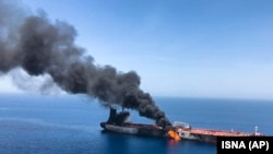 AT SEA -- An oil tanker is on fire in the sea of Oman, June 13, 2019.