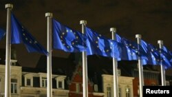 Belgium -- EU flags fly outside the European Commission headquarters in Brussels, October 30, 2014