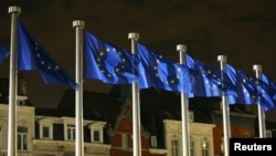 Belgium -- EU flags fly outside the European Commission headquarters, in Brussels, October 30, 2014