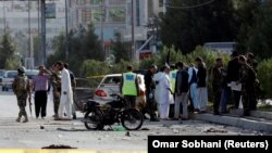 Afghan security forces inspect the site of a suicide attack in Kabul on September 9.