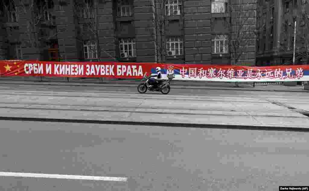 """A banner in central Belgrade on April 18 saying: """"Serbs And Chinese, Brothers Forever.""""  Ognjen Zoric, a Serbian journalist with RFE/RL's Balkan Service, says there is genuine goodwill toward China among the Serbian public, especially after the 1999 NATO bombing of Yugoslavia that China opposed, but signs like these may be aimed at getting the EU's attention. Serbia has been a candidate for EU accession since 2011."""