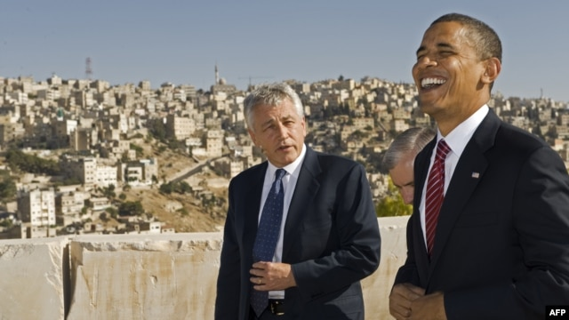 U.S. President Barack Obama (right) shares a laugh with U.S. Senator Chuck Hagel as they tour the citadel of the Jordanian capital Amman. (file photo)