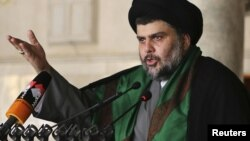 Muqtada al-Sadr delivers a sermon to worshippers during Friday Prayers at the Kufa Mosque near Najaf on May 10.