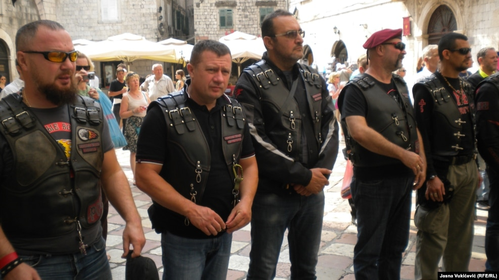 Cossacks and bikers in leather jackets gather in front of St. Nicholas Church in Kotor, Montenegro, where they listened to the liturgy of priest Momcilo Krivokapic.