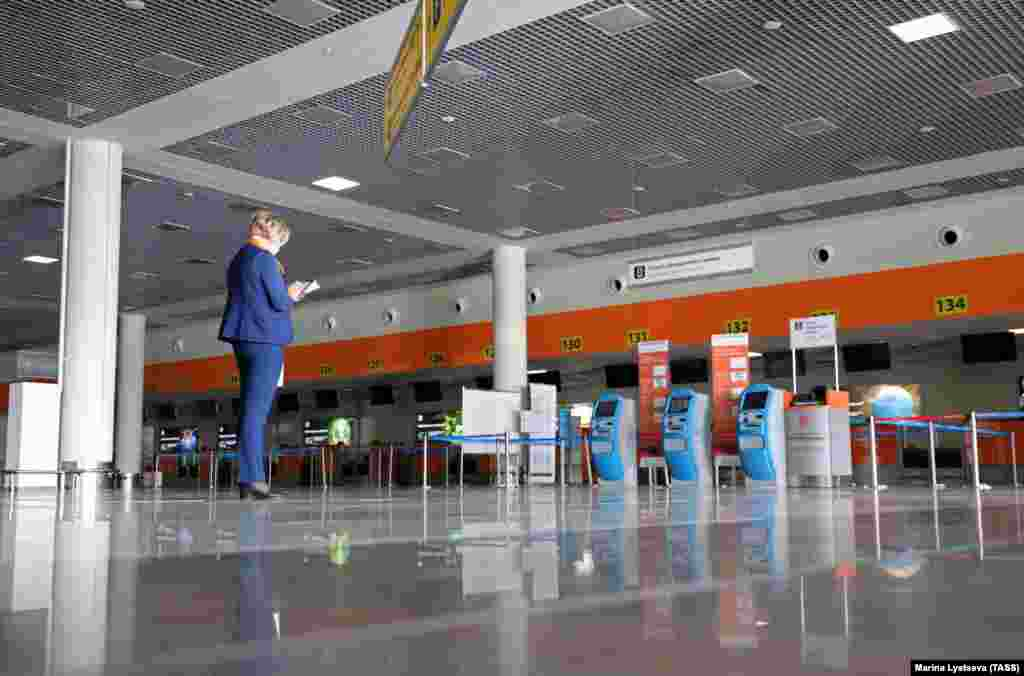 Deserted check-in desks in the empty departures hall at Moscow's Sheremetyevo International Airport on March 27